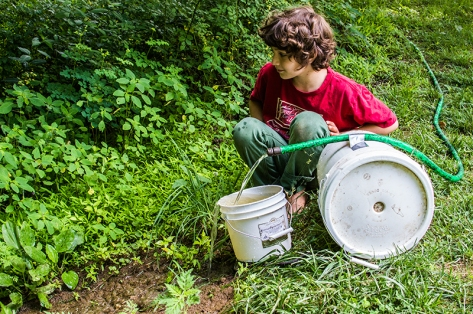 having siphoned water from the pond he sets out to gravity feed the pool in the creek below . . ...